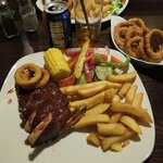 My meal; 1/2 Rack of pork ribs with dressed salad, onion rings, chips and Coke.