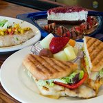 Chicken Panini with fruit, cheesecake, Mahi-Mahi