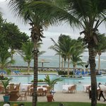View of pool and beach as they set up for outdoor Caribbean night dinner