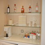 Brand new bottles of liquor at mini bar in room