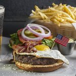 sunnyside up egg on a burger with a black and tan