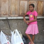 A beautiful young girl in Mahe' helping Mum and Sister with shopping