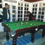Trying a game of snooker
