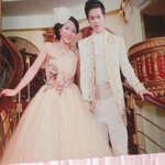 bridal couple down beautiful staircase of hotel see the details