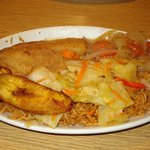 Tiebdjen - national dish in Senegal (fish, cabbage, carrots, plantain)