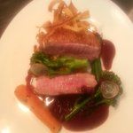 Duck breast with a root veg hash and a rich cherry jus topped with parsnip crisp