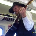 HARMONICA PLAYER ON THE TRAIN