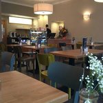 The interior is bright and airy, plenty of room between tables and there's also comfy sofas