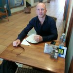 Darren Lockyer enjoying a freshly made sandwich in the peace and quiet of the arcade.