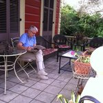 Leisurely reading the paper on the front porch… or is it called a veranda?