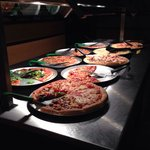 The pizzas were fresh, looked tasty but for the most part were tasteless