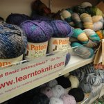 The shelves contain complete collections of Patons, Bernat, Lily, and Phentex yarns