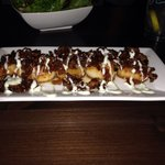 Pan seared scallops with onion bacon marmalade wasabi cream drizzle