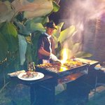Our chef cooking in our villa.