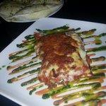 Colourful tasty carbonara and garlic bread.