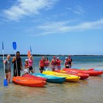 A happy group of kayakers ready to venture out to Bribie Island for an explore