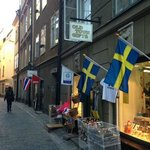 The front door to the block is between the Swedish & Thai flags