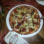 delicious thin crust pizza( pepperoni, green pepper, onion)