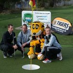 Roary the Tiger takes on two professional golfers