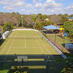 Enjoy a hit on our full size synthetic grass tennis court
