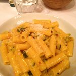 zucchini, pumpkin, saffron filled pasta dish with pecorino cheese