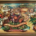 """Mural showing the history of """"La Reunion Colony"""", found in the lobby"""