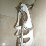 broken shower head holder, shower head is dangling down