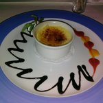 Creme caramel with chocolate drizzle and a fruit drizzle. Cold rather than room temperature