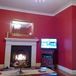 Cosy fireplace and red walls, whats not to love