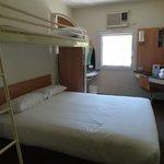 Queen bed with overhead bunk