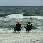 Couple sitting by the waters edge