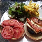 The alpaca/beef burger, amended to customer order, bacon cooked more
