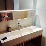 bathroom vanity in the main area of the room.