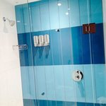 Modern shower with built-in soap/shampoo/conditioner.