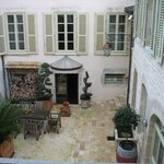 The rooms look out on the charming courtyard