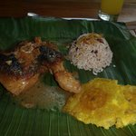 lunch a typical costa rican chicken in cocunt milk with gallo pinto rice and beans and a banana