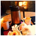 Fresh coffee and doughnuts delivered fresh to your room each morning upon request. Can't beat th