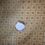 Hole burnt in bedding (non-smoking room)