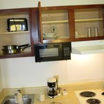 Very few dishes & utensils, these overhead cabinets stuck ... quite difficult to open