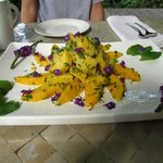 Fresh pineapple with edible flowers on top!