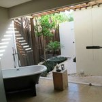 Bathroom looking to outdoor shower with little gaps in fence :-(
