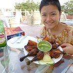 full tandoori chicken at roof top restaurant, best we ever had. Cold beer, nice breeze.