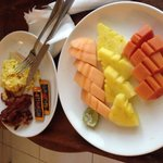 Fruit platter and eggs w bacon room service