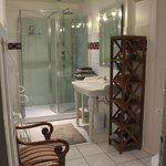 a large modern bath in this antique chateau