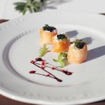 Smoked salmon rolls with black caviar