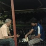Is anybody interested in chess with the owner ? (The uncle in peach coloured shirt.