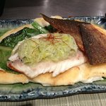 fresh sea bass with its crispy skin separated