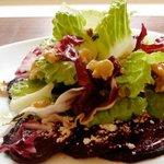 Organic Romaine & Radicchio Salad on a Bed of Roasted organic Beets with lemon-walnut vinaigrett
