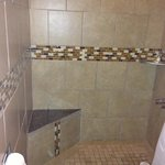 Newly renovated shower with mosaic finish