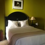 Petite Queen rooms appointed with fine art touches